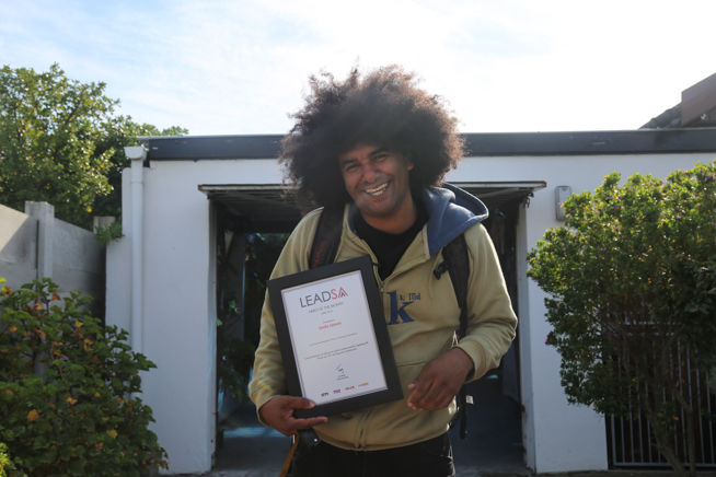 Emile Jansen aka Emile YX? with his certificate for named Lead SA Hero of The Month for April 2016 - Photo via Lead SA