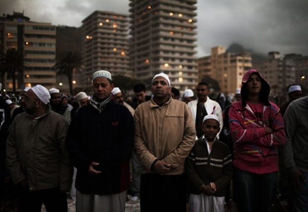 Every year thousands of Muslim men gather at Seapoin Promenade, Cape Town, for prayers and the sighting of the new moon which signals the start and will also a month later signal the end of Ramadan.