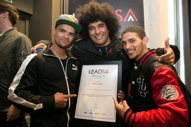 Emile YX (centre) with members of Heal The Hood showing of the Hero of The Year 2016 certificate Emile has been awarded. Photo: Heal the Hood