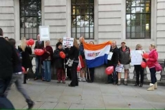 Image is for illustration purposes only and shows the old SA flag being displayed at a protest in front of SA House, London, UK in October 2013.